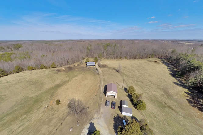 Home, horse barn, equipment barn, storage sheds & fenced pasture